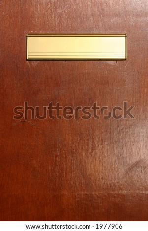 Gold colored letterbox. - stock photo