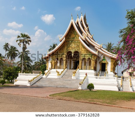 Gold coloured Buddhist Temple in the UNESCO listed Laos city of Luang Prabang. - stock photo