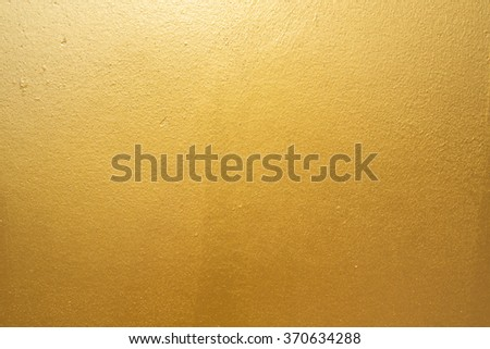 Gold concrete wall on background texture. - stock photo