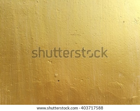 Gold concrete wall texture background - stock photo