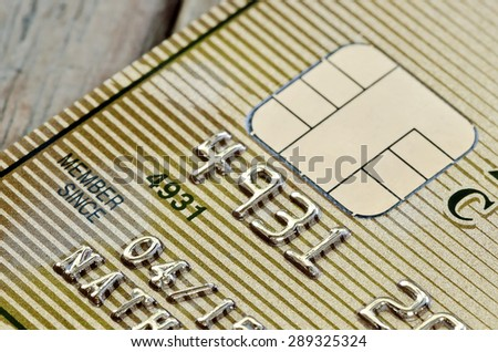 Gold credit card in close up view,shallow DOF - stock photo
