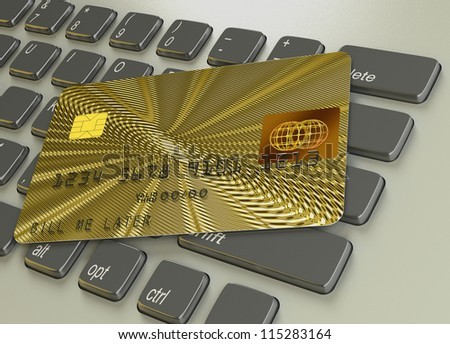 Gold credit card on a laptop pc keyboard - stock photo