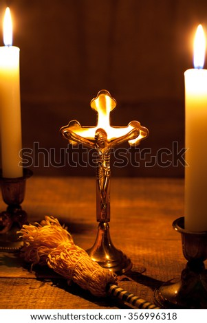 Gold cross with candles and 