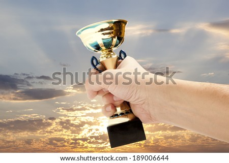 Gold Cup winner against the blue sky  - stock photo