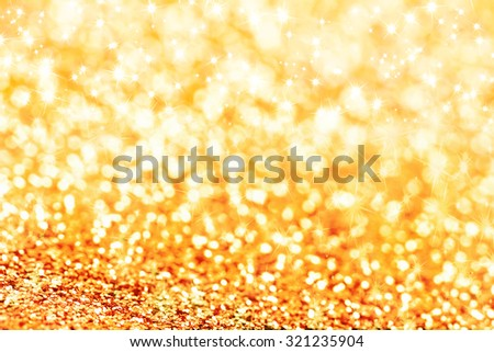 Gold defocused glitter background with copy space - stock photo