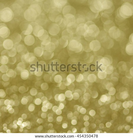 Gold defocused glitter background with copy space./Gold defocused glitter background with copy space. - stock photo