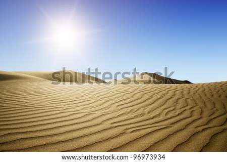 Gold desert into the sunset. Canary Islands, Canaries. Grand Canary. Maspalomas, Resort Town. - stock photo