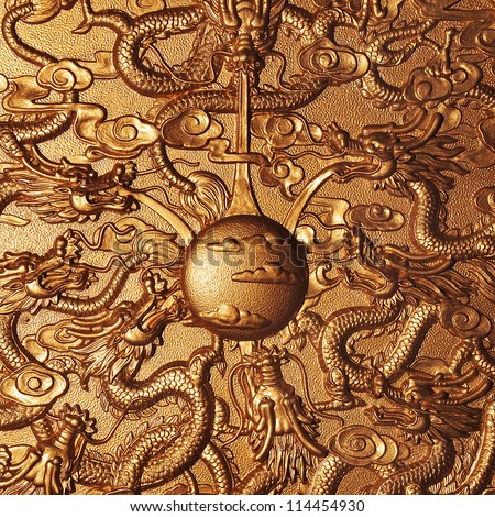 Gold dragon around the gold marble background - stock photo