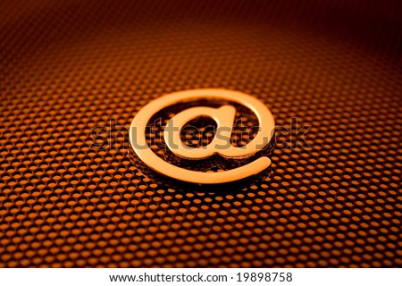 gold e-mail symbol & technology background See all metal letters in my portfolio - stock photo