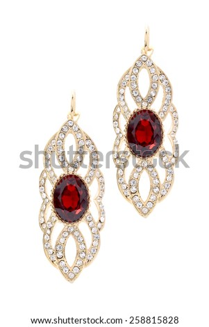 gold earrings with ruby on white background - stock photo