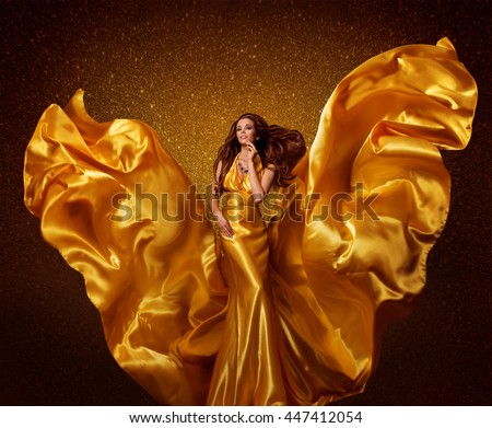 Gold Fashion Model Woman, Silk Fabric Flying as Wings on Wind