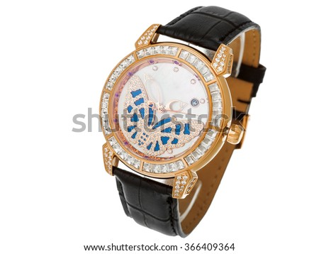 Gold Female watch with a leather thong and the dial from gold and jewels, the dial with a butterfly from diamonds. The isolated image on a white background, nobody. - stock photo