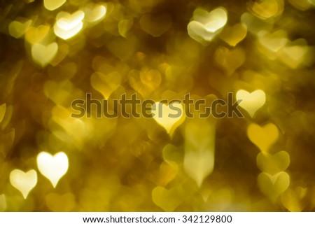 Gold festive background bokeh hearts - stock photo