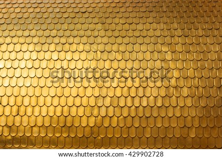 Gold fish or dragon squama style scales textured background