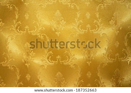 Gold flower vintage fabric background