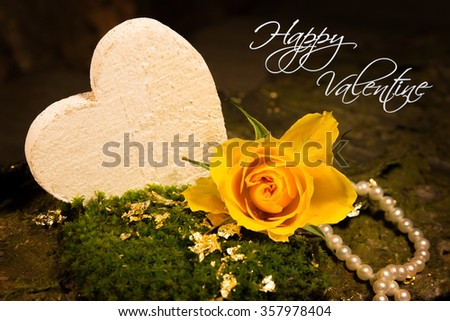 Gold foil, a yellow rose and a white heart titled Happy Valentine - stock photo