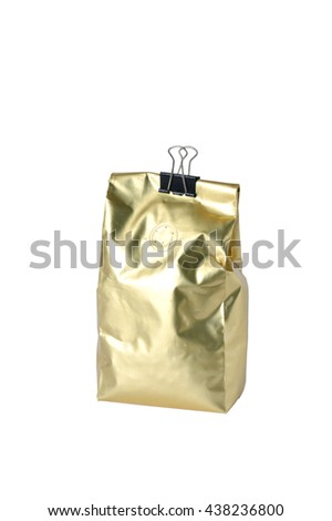 Gold foil coffee bean bag isolated on white background. - stock photo