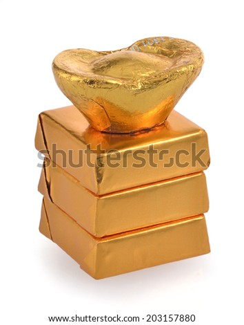 Gold foil wrapped chocolates on white background  - stock photo