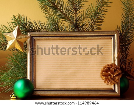 gold frame and Christmas decorations (Christmas tree and balls) - stock photo