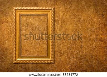 Gold frame on a yellow wall background
