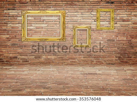 gold frame on stone wall for background. - stock photo