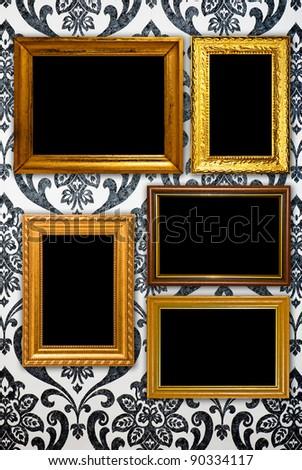 Gold frame on vintage wallpaper background - stock photo