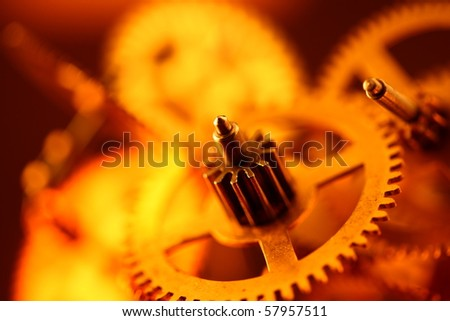 Gold gears old clockwork - macro with a depth of field - stock photo