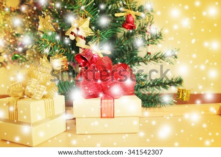 Gold gift box on abstract golden Christmas background