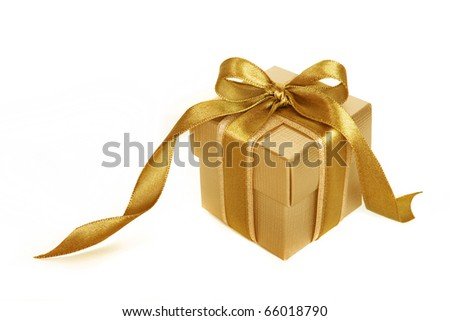 Gold gift box with gold ribbon - stock photo