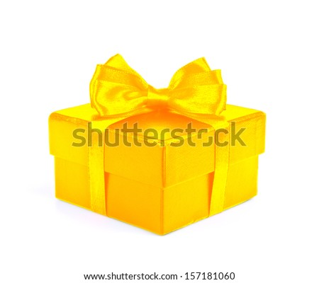 Gold gift box with gold ribbon bow isolated on white background.