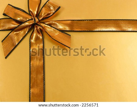 Gold gift with shinny ribbon and bow