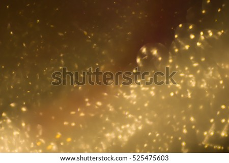 Gold glitter abstract background Bokeh Christmas.