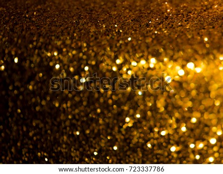 Gold Glitter Christmas Lights Abstract Background. De Focused.
