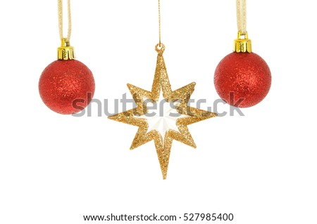 Gold glitter Christmas star and red baubles isolated against white