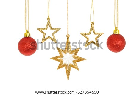 Gold glitter Christmas stars and red baubles isolated against white