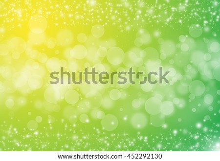 Gold glitter sparkles rays lights bokeh festive elegant abstract background.