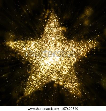 Gold glitter star of blinking stars - stock photo