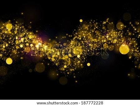 Gold glittering background .Glittering stars on bokeh background. Sparkling glitters on black background - stock photo
