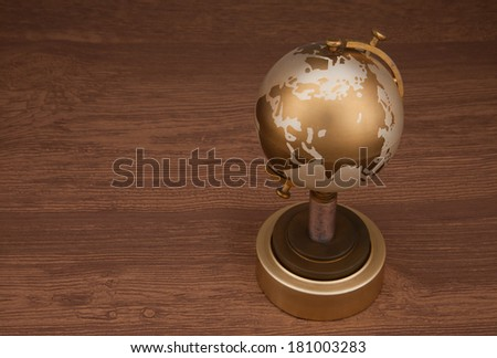 Gold globe brown background