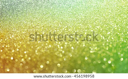 Gold green nuggets sparkling carpet. Close-up view, very shallow deep of field . Macro.