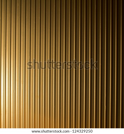 Gold grooved metal texture - stock photo