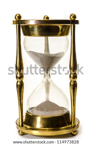 Gold hourglass isolated on white background.