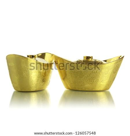 Gold ingot on white background - stock photo