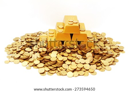Gold ingots and coins - stock photo