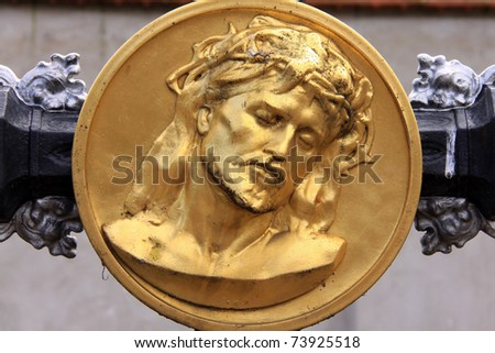 Gold Jesus on the old Prague Cemetery, Czech Republic - stock photo