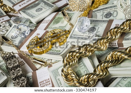 Gold jewelry, bling and money