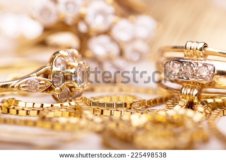 Gold jewelry for elegant women. - stock photo