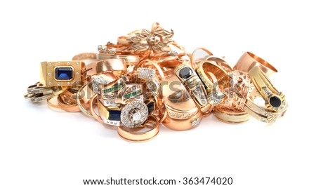 gold jewelry on a light background - stock photo