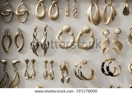 Gold jewelry on a white background.
