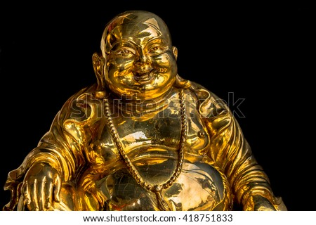 Gold Kasennen statue on a Black background